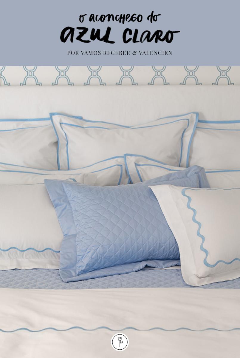 cama com roupa azul e branca valencien